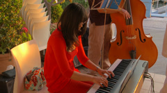 Female jazz pianist with trio Stock Footage