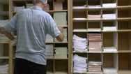 Stock Video Footage of Business Worker Sorts Company Forms Time Lapse