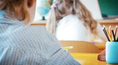 Beautiful young female teacher standing near blackboard in school - stock footage