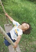 Carefree child swinging Stock Photos