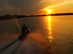 Waverunner towards sunset 01 Stock Footage
