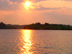 Jet ski crosses lake at sunset 02 - stock footage
