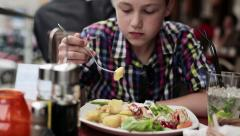 Young teenager eating lunch in restaurant HD Stock Footage