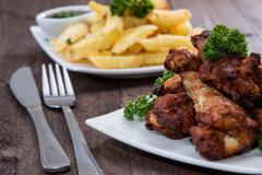 mixed fingerfood on wood - stock photo