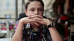 Pensive, thoughtful teenager in cafe, steadicam shot HD Stock Footage