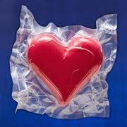 Shrink wrapped heart - stock photo