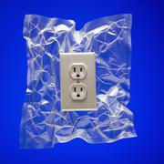Shrink wrapped electricity receptacle - stock photo