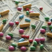 Stock Photo of Diet pills and money