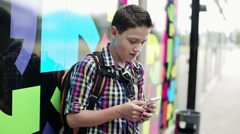 Young teenager with smartphone in the city HD Stock Footage