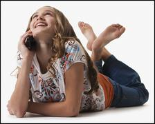 Young girl talking on cell phone Stock Photos
