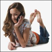 Young girl talking on cell phone - stock photo