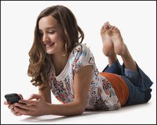 Young girl texting Stock Photos