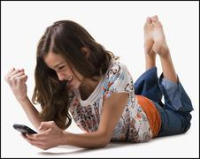 Young girl texting - stock photo