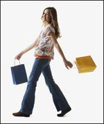 Young girl holding shopping bags - stock photo