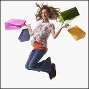 Young girl holding shopping bags Stock Photos
