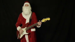 Santa Claus playing a guitar - stock footage