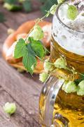 mug of beer with hop (macro shot) - stock photo