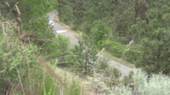 Motorsports, hill-climb, white Mitsubishi Evo above follow Stock Footage