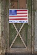 God bless American sign on barn door Stock Photos