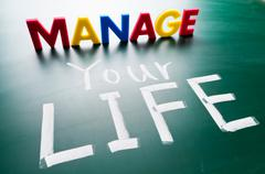 manage your life, conceptual words on blackboard. - stock photo
