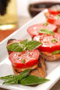 bruschetta topped with fresh tomato and basil - stock photo