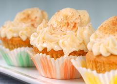 Vanilla cupcake with cream cheese frosting and sliced bananas Stock Photos
