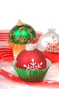 Christmas ornaments in cupcake liners Stock Photos