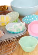 Variety of cupcake liners with wire whisk Stock Photos