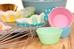 Variety of cupcake liners with wire wisk Stock Photos