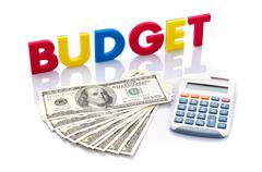 budget words, american banknotes and calculator - stock photo