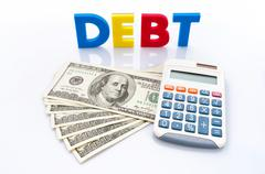 debt words, american banknotes and calculator - stock photo