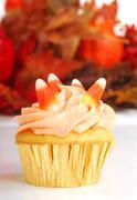 halloween cupcake with fall foliage - stock photo