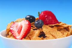 bran cereal with blueberries, strawberries - stock photo