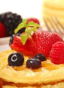 Fresh waffles with fruit Stock Photos