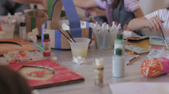 Children creating artworks at school: colors, art, brushes, papers, drawings Stock Footage