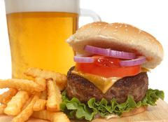 Cheeseburger with french fries and beer Stock Photos