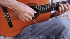 Guitarist playing his acoustic guitar on the street: chords, fingers, musician Stock Footage