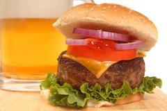 Cheeseburger and a beer Stock Photos