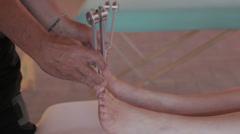 tuning fork massage on feet: relaxing, alternative medicine, chiropractor - stock footage