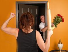Man coming home late to angry wife Stock Photos