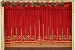 Theatrical red curtain Stock Photos