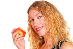 Healthy young woman eating an apple Stock Photos