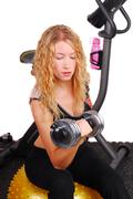 attractive woman lifting dumb bell - stock photo