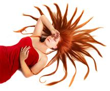 Woman with starburst red hair Stock Photos