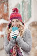 Stock Photo of USA, Utah, Salt Lake City, portrait of young woman in winter clothing drinking