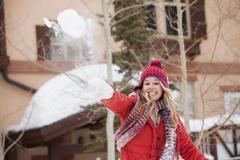 Stock Photo of USA, Utah, Salt Lake City, Portrait of young woman throwing snowball