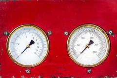 Old red industry panel with two analog meters Stock Photos