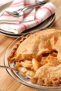 Whole deep dish apple pie with a flaky crust Stock Photos