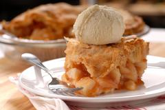Piece of apple pie with a flaky crust and vanilla ice cream Stock Photos