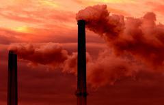 smokestacks billowing smoke adding to global warming - stock photo